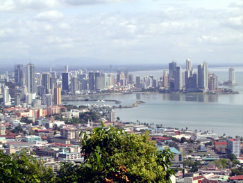 Panama City (shortly after 2000)-- Areas of Balboa Boulevard, Bay of Panama, banking area in Marbella (left background), and Paitilla (the latter in the right background) -- photographed from top of Ancon Hill.  Older parts of the city are in the foreground. The lone high-rise building on the far right background (to the right and behind Paitilla area) was the beginning of the new Punta Pacifica area created by landfill of area near the site of the former Paitilla airport now at Albrook.  [Photo courtesy of Inteoceanic Region Authority (ARI) website, www.ari.gob.pa]